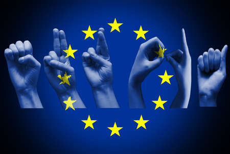 word europa over the european union flag deaf sign on black Foto de archivo