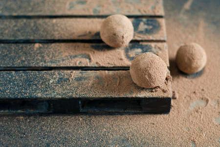 Homemade chocolate truffles on the dark background Standard-Bild
