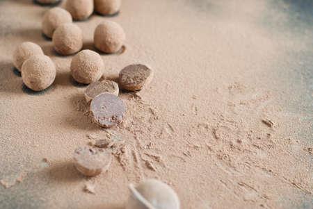 Homemade chocolate truffles and raw cocoa powder
