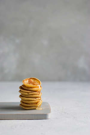 Mini pancakes on the light background Standard-Bild