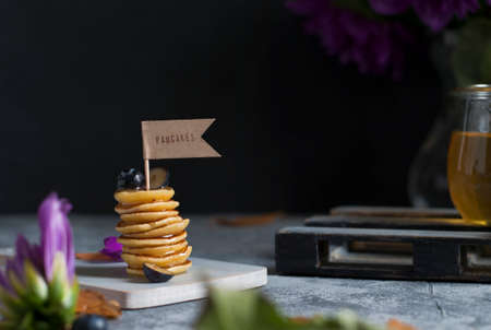 Mini pancakes with honey and berries