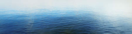 Baltic sea on a sunny summer day, clear blue sky, reflection in the water. Abstract natural pattern, texture, background, wallpaper. Nature, environment, ecology concepts. Panoramic image