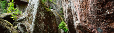 Granite rocks and canyons in Finland, texture close-up. Picturesque panoramic scenery. Dark atmospheric landscape. Pure nature, ecology, environmental conservation, eco tourism, travel destinations