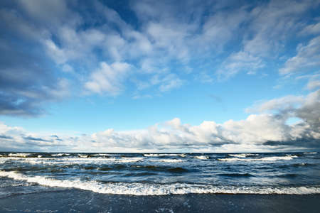 Storm clouds above the Baltic sea, cyclone in winter. Dramatic sky, waves and water splashes. Germany. Ecology, climate change, global warming concepts
