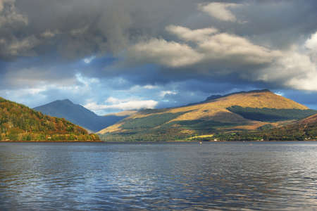 A view of the shores, forests and hills near the Loch Fyne on a cloudy day. Inveraray, Inner Hebrides, Argyll and Bute, Scotland, UK