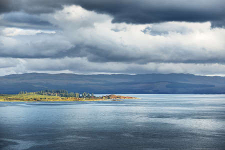Panoramic view of the rocky shores and forests of a small village Ardrishaig. Loch Fyne, Crinan canal, Argyll and Bute, Scotland, UK