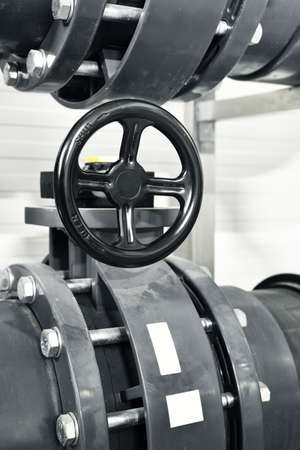 Close-up of pipeline in city water treatment boiler room