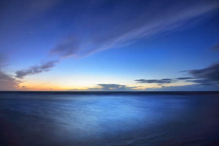 Stunning view of the Baltic sea under a dark blue starry sky with colorful clouds, long exposure. Denmark Stok Fotoğraf