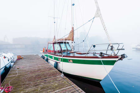 The morning fog. A view of the yacht club, sailing boats close-up. Riga, Latvia