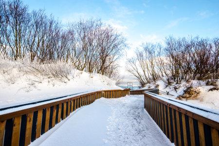 A road to the sea, snow-covered seacoast. Baltic sea, Latvia