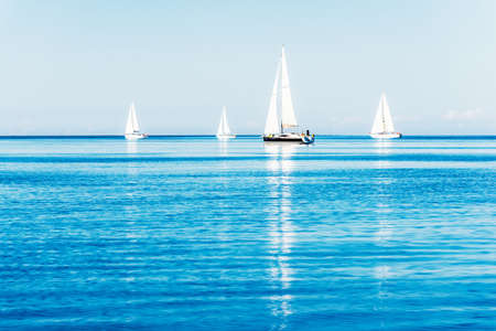 Sailing yacht regatta. Sloop rigged yachts close-up. Clear summer day. Kiel, Germany