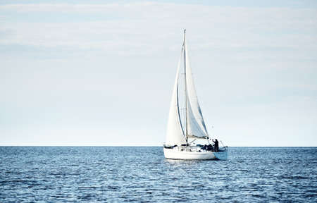 Yacht sailing in calm water in the gulf of Riga