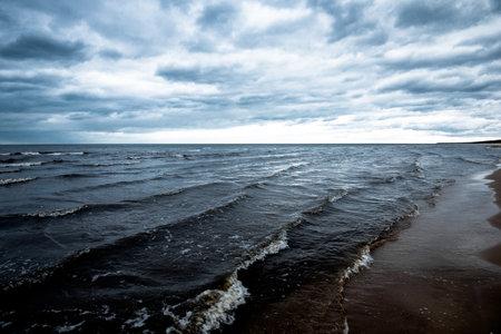 Spring landscape. Dark stormy sky over the Baltic sea, Latvia Standard-Bild