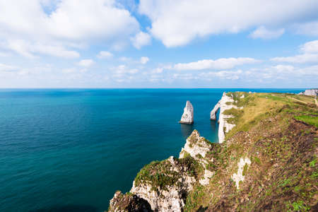 Aerial view of the Etretat white cliffs. Clear blue sky. Normandy, France