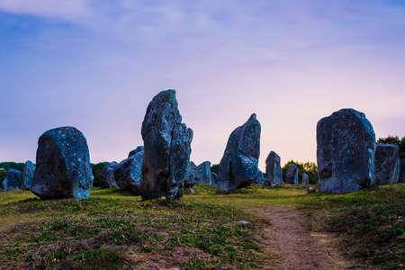 Ancient menhir granite stones at night. Carnac, France