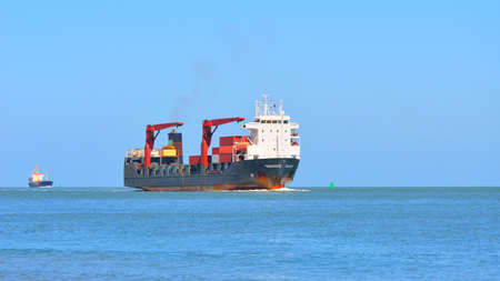 Cargo ship sailing in blue sea near to Vlissingen, the Netherlands