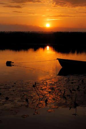 river bank sunset Foto de archivo
