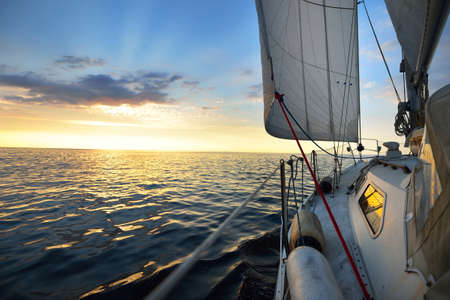 View from the deck of a yacht sailing in calm baltic sea at th evening Standard-Bild