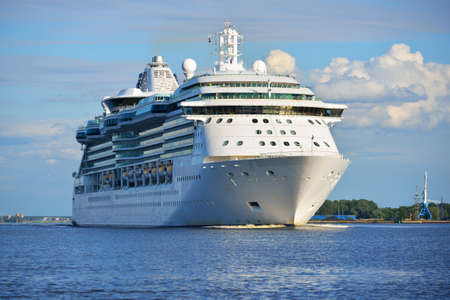 Big cruise ship leaving port of Rige on a sunny summer day