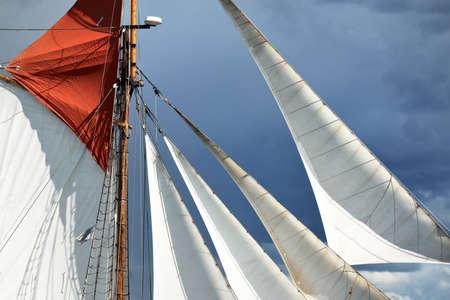 An elegant two-masted gaff schooner (tall ship, sailboat) sailing in Mälaren lake, Sweden. Travel, history, transportation, sailing, sport, cruise, regatta, nautical vessel. Panoramic view