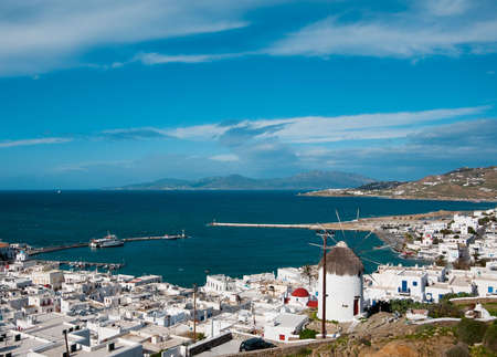 petrol powered: Top view of the port and the Chora of Mykonos Island of the hill with windmills Stock Photo