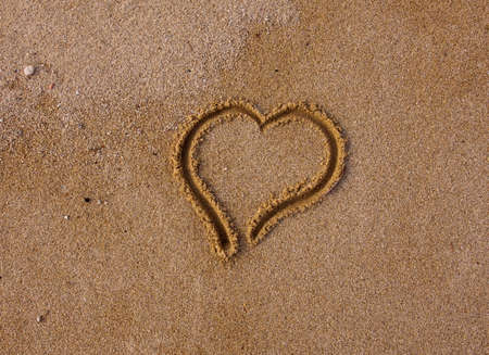 africa kiss: heart, drawn in the sand - a sign of love...