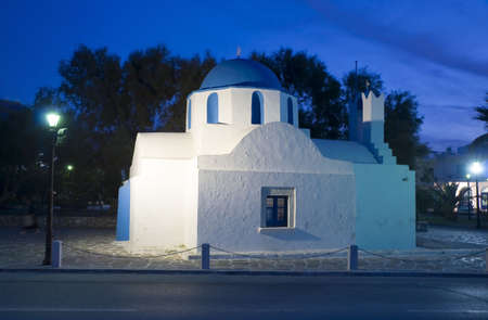 The Greek Church in the night the lights on the island of Paros photo