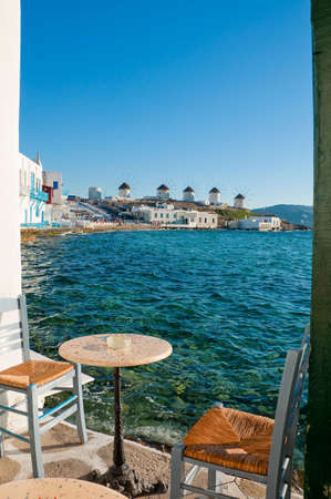 the little venice: View of the famous windmills of Mykonos Island of the cafe at Little Venice ... Greece. Stock Photo