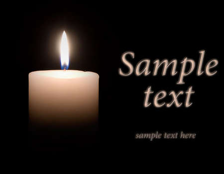 White wax candle is lit in the dark Stock Photo - 7974254