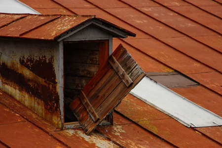 Rusty roof with window to the attic loft style vintage Stock Photo