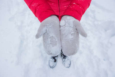 Ivory woman gloves in snow with red coat