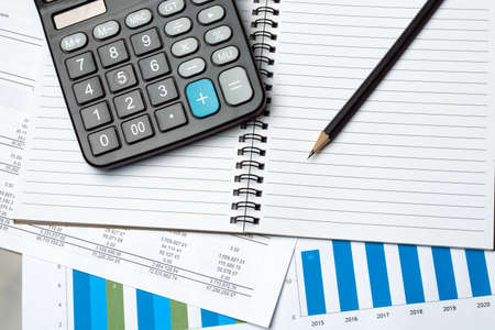 Notebook, Pencil And Calculator On Financial Report - Business Accounting Concept