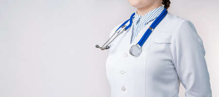Cropped view of Woman doctor in a white coat with stethoscope. Isolated over white background. Copy space for your text Foto de archivo