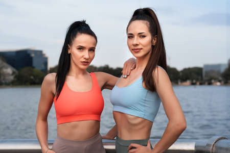 Young women relax after a fitness workout in the open air. Concept of a healthy lifestyle