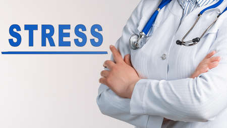 Word STRESS on a white background. Nearby is a doctor in white coat and stethoscope. Medical concept