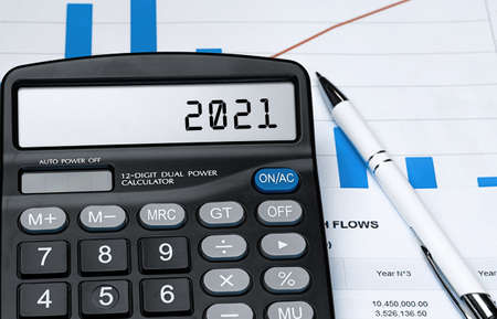 Calculator with the word 2021 on the display. Money, finance and business concept Stock fotó