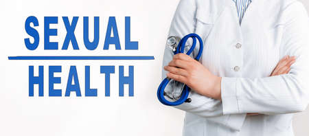 Text SEXUAL HEALTH on a white background. Nearby is a doctor in white coat and stethoscope. Medical concept