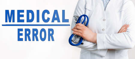 Words - medical error on a white background. Nearby is a doctor in white coat and stethoscope. Medical concept