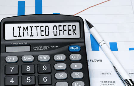 Calculator with the word LIMITED OFFER on the display. Money, finance and business concept Stock fotó