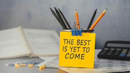 The best is yet to come - concept of text on sticky note. Closeup of a personal agenda