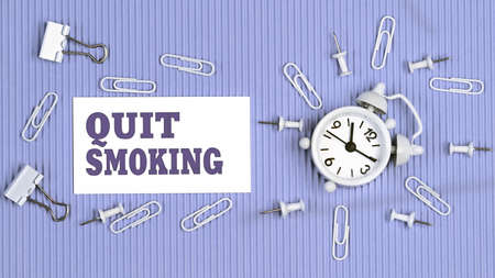 Quit Smoking - concept of text on business card. Closeup of a personal agenda