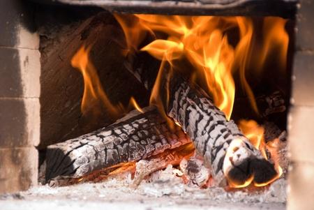 earthen: Fire burning in earthen oven