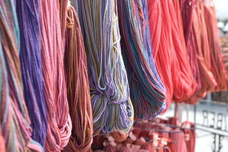 Skeins of colorful yarn hanging