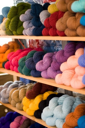 Wood shelves filled with colorful skeins of yarn Stok Fotoğraf - 10476786