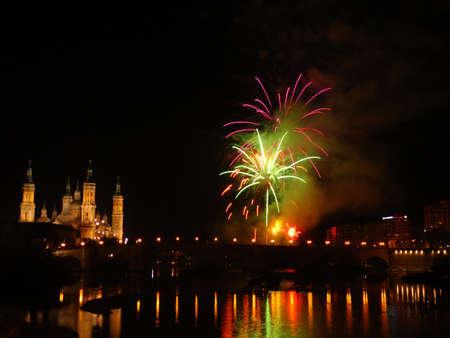 zaragoza: Lively fireworks by the river Ebro in Zaragoza Editorial