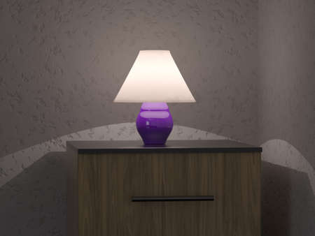 small lamp: A small lamp on the bedside table