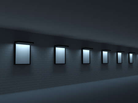 Dark gallery with paintings on the brick wall photo