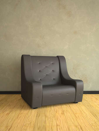 Black leather armchair near an old wall photo