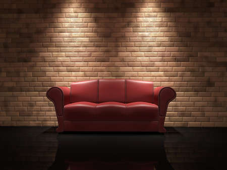 Red leather sofa near a brick wall photo