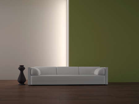 White sofa and vase near a wall photo